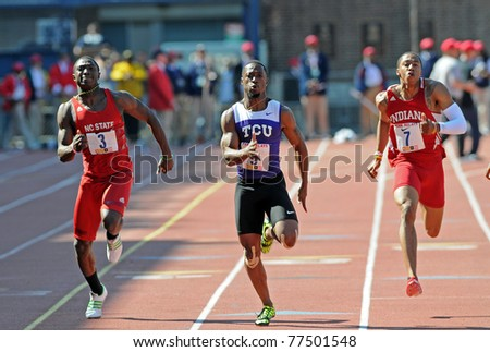 PHILADELPHIA - APRIL 30: Charles Silmon from TCU (center) holds a small lead in the College Men's 100 meter Dash Championship at the 117th Penn Relays in Philadelphia. Silmon finished second. - stock photo