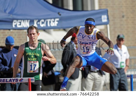 PHILADELPHIA - APRIL 29: Keon Melson from Fort Valley State (#15) knocks over a hurdle during the College Men's 400 meter championship at the 117th Penn Relays on April 29, 2011 in Philadelphia, PA - stock photo