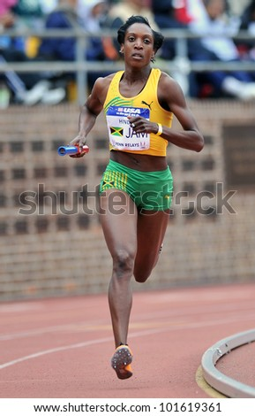 PHILADELPHIA - APRIL 28: Korene Hinds from Jamaica runs the anchor leg of the sprint medley at the Penn Relays April 28, 2012 in Philadelphia.