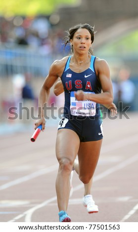 PHILADELPHIA - APRIL 30: Monica Hargrove  from the U.S., heads through the shade on the back straight during the Olympic Development 4x400 ladies relay at the 117th Penn Relays in Philadelphia. - stock photo