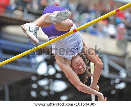 PHILADELPHIA - APRIL 28: Sean Daugherty from Lake Braddock HS competes in the boys high school pole vault championship at the Penn Relays April 28, 2012 in Philadelphia. - stock photo