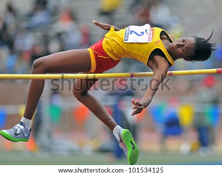PHILADELPHIA - APRIL 26: Shanice Hall from Wolmers HS competes in the girls high school high jump championship at the Penn Relays April 26, 2012 in Philadelphia. - stock photo
