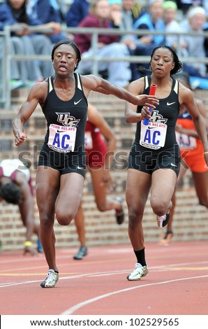 PHILADELPHIA - APRIL 26: Sheila Paul from UCF (front) takes the baton on the anchor leg of a ladies college 4x100 heat at the Penn Relays April 26, 2012 in Philadelphia.