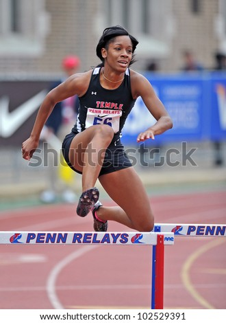 PHILADELPHIA - APRIL 26: Tessa West from Temple clears a hurdle easily in the ladies 400 meter college championships at the Penn Relays April 26, 2012 in Philadelphia. - stock photo