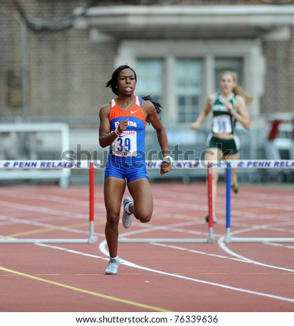 PHILADELPHIA - APRIL 28: University of Florida's Amani Bryant  (#39) heads down a straight in the women's 400 meter Hurdles Championship at the 2011 Penn Relays on April 28, 2011 in Philadelphia, PA - stock photo