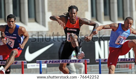 PHILADELPHIA - APRIL 29: University of Florida's William Wynne (center) clears a hurdle during the College Men's 400 meter championship at the 117th Penn Relays on April 29, 2011 in Philadelphia, PA - stock photo