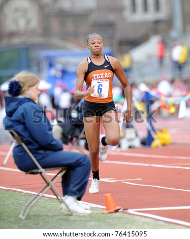 PHILADELPHIA - APRIL 28: University of Texas long jumper A'Lexus Brannon sprints down the runway for a jump during the ladies competition at the 117th Penn Relays on April 28, 2011 in Philadelphia, PA