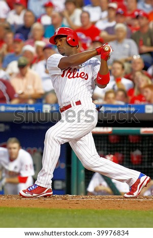 PHILADELPHIA - AUGUST 20: Phillie's Jimmy Rollins (11) hits a ground ball to third during the game between the Diamondbacks and the Phillie's at Citizens Bank Park on August 20, 2009 in Philadelphia - stock photo
