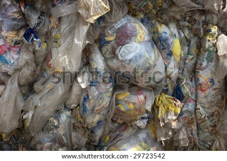 PHILADELPHIA - CIRCA 2008: Baled wrapping plastic bags and at an undisclosed recycling facility circa 2008 in Philadelphia. The plastic is gathered by type and will be recycled. - stock photo