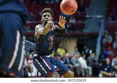 PHILADELPHIA - DECEMBER 2: Fairleigh Dickinson Knights guard Darian Anderson (2) makes a pass from the point during a NCAA basketball game December 2, 2015 in Philadelphia.  - stock photo