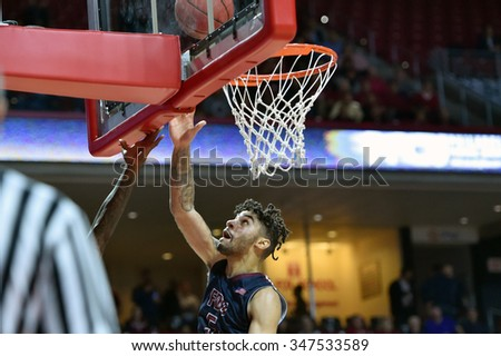 PHILADELPHIA - DECEMBER 2: Fairleigh Dickinson Knights guard Earl Potts Jr. (5) puts up a shot during a NCAA basketball game December 2, 2015 in Philadelphia.