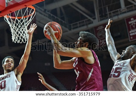 PHILADELPHIA - DECEMBER 13: Saint Joseph's Hawks forward DeAndre Bembry (43) hangs in the air to take a shot close to the basket during the Big 5 basketball game December 13, 2015 in Philadelphia.