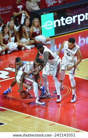 PHILADELPHIA - DECEMBER 28: Temple Owls guard Devin Coleman (34) fights for a loose ball in the lane during the NCAA basketball game December 28, 2014 in Philadelphia.