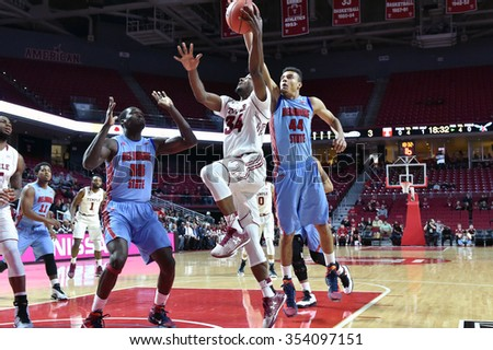 PHILADELPHIA - DECEMBER 19: Temple Owls guard Devin Coleman (34) goes up for a shot during the basketball game December 19, 2015 in Philadelphia.  - stock photo