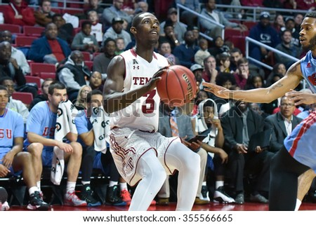 PHILADELPHIA - DECEMBER 19: Temple Owls guard Levan Shawn Alston Jr. (3) prepares to go up for a shot during the basketball game December 19, 2015 in Philadelphia.  - stock photo