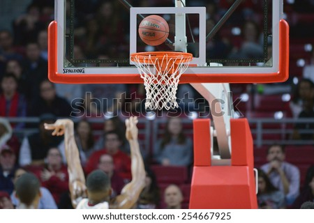 PHILADELPHIA - FEBRUARY 10:  A ball hangs above the rim after a shot during the AAC conference college basketball game February 10, 2015 in Philadelphia.  - stock photo