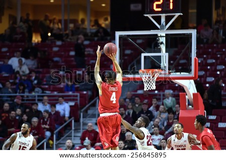 PHILADELPHIA - FEBRUARY 26: Houston Cougars guard LeRon Barnes (4) shoots a jumper during the AAC conference college basketball game  February 26, 2015 in Philadelphia.  - stock photo