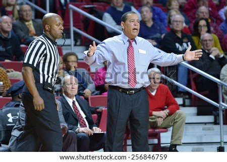 PHILADELPHIA - FEBRUARY 26: Houston Cougars head coach Kelvin Sammpson gestures from the sideline during the AAC conference college basketball game  February 26, 2015 in Philadelphia.  - stock photo