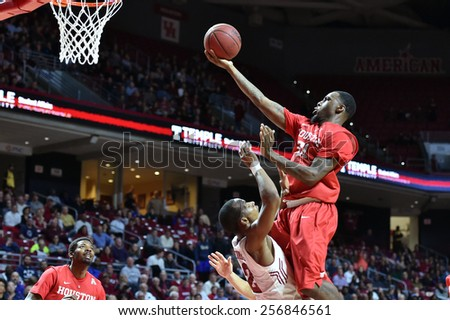 PHILADELPHIA - FEBRUARY 26: Temple guard Will Cummings (2) draws a charging foul as Houston guard Jherrod Stiggers (21) crashes into him during a basketball game  February 26, 2015 in Philadelphia - stock photo
