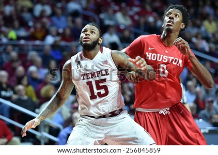 PHILADELPHIA - FEBRUARY 26: Temple Owls forward Jaylen Bond (15) blocks out a Houston player for a rebound during the AAC conference college basketball game  February 26, 2015 in Philadelphia.  - stock photo