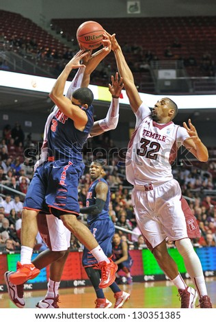 PHILADELPHIA - FEBRUARY 28: Temple Owls forward Rahlir Hollis-Jefferson (32) goes for a block of Detroit Titans guard Ray McCallum (3) during the basketball game February 28, 2013 in Philadelphia.