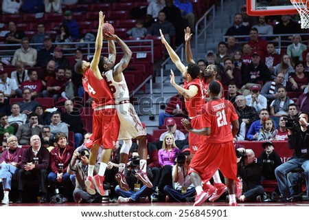 PHILADELPHIA - FEBRUARY 26: Temple Owls guard Quenton DeCosey (25) takes a shot surrounded by Houston players during the AAC conference college basketball game  February 26, 2015 in Philadelphia.  - stock photo