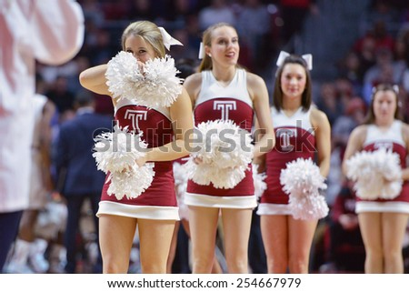 PHILADELPHIA - FEBRUARY 10:  The Temple cheerleaders perform during the AAC conference college basketball game February 10, 2015 in Philadelphia.  - stock photo