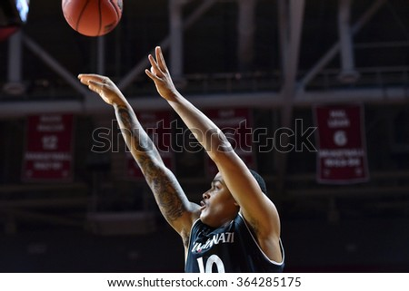 PHILADELPHIA - JANUARY 16: Cincinnati Bearcats guard Troy Caupain (10) takes a jump shot during the American Athletic Conference basketball game January 16, 2016 in Philadelphia.  - stock photo