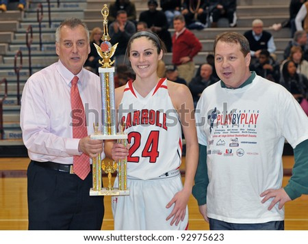 PHILADELPHIA - JANUARY 14: Don Tollefson (l) and Jeremy Treatman (r) present Rachel Pearson with an MVP award in the Rally Girls Play by Play Classic January 14, 2012 in Philadelphia. - stock photo