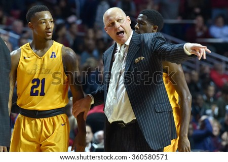 PHILADELPHIA - JANUARY 9: East Carolina Pirates head coach Jeff Lebo talks to one of his payers during a timeout in the American Athletic Conference  basketball game January 9, 2016 in Philadelphia.  - stock photo