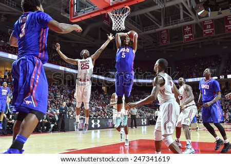 PHILADELPHIA - JANUARY 14: Southern Methodist Mustangs forward Markus Kennedy (5) elevates for a dunk during the AAC conference college basketball game January 14, 2015 in Philadelphia.  - stock photo