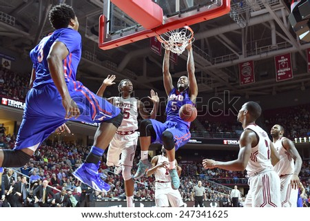 PHILADELPHIA - JANUARY 14: Southern Methodist Mustangs forward Markus Kennedy (5) finishes a dunk during the AAC conference college basketball game January 14, 2015 in Philadelphia.  - stock photo