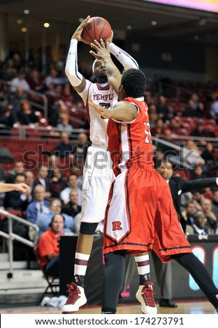 PHILADELPHIA - JANUARY 28: Temple Owls forward Anthony Lee (3) takes a shot with a defender in his face during an AAC basketball game January 28, 2014 in Philadelphia.