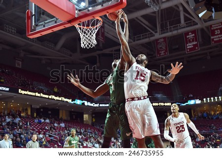 PHILADELPHIA - JANUARY 22: Temple Owls forward Jaylen Bond (15) goes up for a shot during the AAC conference college basketball game January 22, 2015 in Philadelphia.  - stock photo