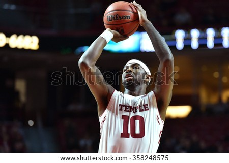 PHILADELPHIA - JANUARY 2: Temple Owls forward Mark Williams (10) shoots a free throw during the American Athletic Conference basketball game January 2, 2016 in Philadelphia.  - stock photo