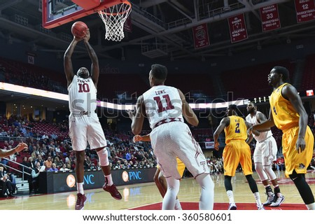 PHILADELPHIA - JANUARY 9: Temple Owls forward Mark Williams (10) takes a shot during the American Athletic Conference  basketball game January 9, 2016 in Philadelphia.  - stock photo