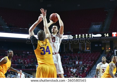 PHILADELPHIA - JANUARY 9: Temple Owls forward Obi Enechionyia (0) takes a jump shot during the American Athletic Conference  basketball game January 9, 2016 in Philadelphia.  - stock photo