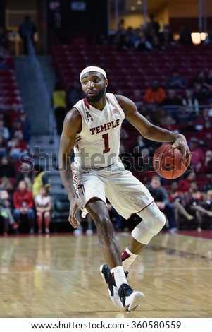 PHILADELPHIA - JANUARY 9: Temple Owls guard Josh Brown (1) dribbles the ball in the front court during the American Athletic Conference  basketball game January 9, 2016 in Philadelphia.  - stock photo