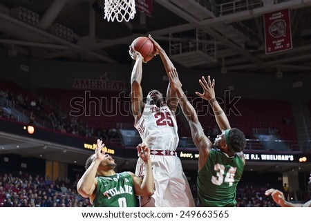PHILADELPHIA - JANUARY 31: Temple Owls guard Quenton DeCosey (25) drives to the basket during the AAC conference college basketball game January 31, 2015 in Philadelphia.