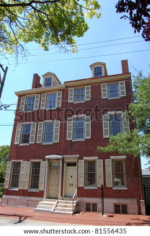 """PHILADELPHIA - JULY 16: The Edgar Allan Poe National Historic Site, shown here on July 16, 2011, was the author's home from 1838-1844. Here, in Philadelphia, PA, Poe wrote """"The Raven"""" and other works - stock photo"""