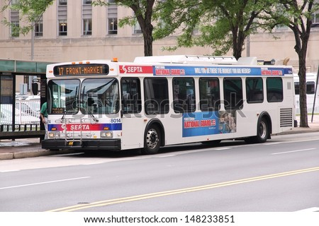 PHILADELPHIA - JUNE 11: People ride SEPTA bus on June 11, 2013 in Philadelphia. SEPTA served almost 321 million rides in 2010. - stock photo