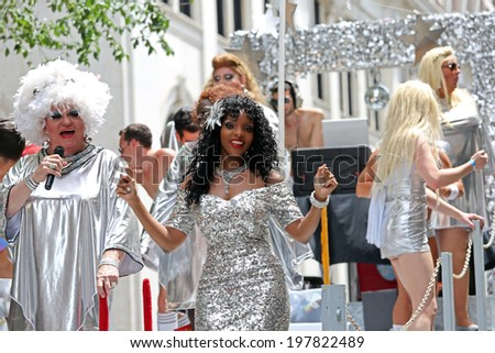 PHILADELPHIA - JUNE 8: People singing at the 26th Annual Pride Parade on the streets of Center City Philadelphia on June 8th, 2014 in Philadelphia.  Hundreds march to support same sex marriage - stock photo