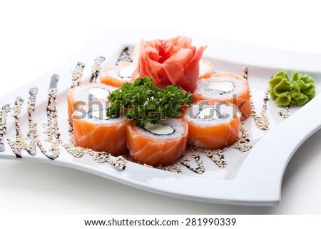 Philadelphia Maki Sushi made of Philadelphia Cream Cheese inside, Fresh Raw Salmon outside. Garnished with Sauce - stock photo
