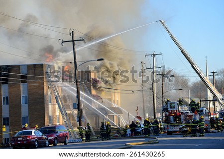 PHILADELPHIA - MARCH 17: Philadelphia firefighters battle a four alarm fire at the Rita Grace Manor Apartments in the 9100 block of Academy Road March 17, 2015 in the northeast section of Philadelphia - stock photo