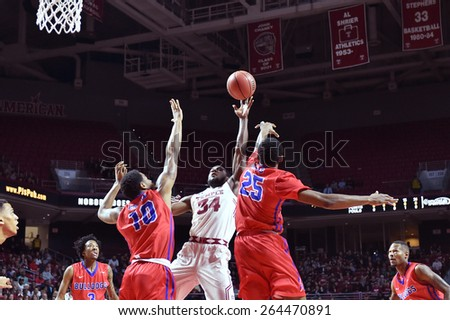 PHILADELPHIA - MARCH 25: Temple Owls guard Devin Coleman (34) puts up a contested shot during the NIT quarterfinal basketball game March 25, 2015 in Philadelphia. - stock photo
