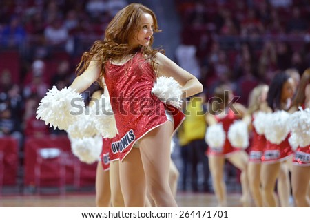 PHILADELPHIA - MARCH 25: The Temple Diamond Gems dance team performs during the NIT quarterfinal basketball game March 25, 2015 in Philadelphia. - stock photo