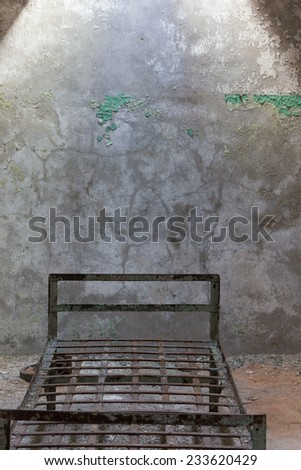 PHILADELPHIA, NOV. 15: Abandoned Cell with metal bed at Eastern State Penitentiary Historic Site located in Philadelphia, PA as seen on November 15, 2014. - stock photo