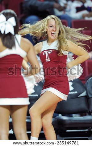 PHILADELPHIA - NOVEMBER 30: A Temple Owls cheerleader dances on the court during the NCAA basketball game November 30, 2014 in Philadelphia. - stock photo