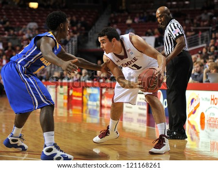 PHILADELPHIA - NOVEMBER 25: Temple basketball guard T.J. DiLeo is guarded closely by a defender in a non conference game against Delaware November 25, 2012 in Philadelphia.