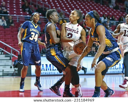 PHILADELPHIA - NOVEMBER 14:  Temple guard Feyonda Fitzgerald (2) collides with an Explorer defender during the season opening ladies basketball game against LaSalle November 14, 2014 in Philadelphia.